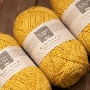 Blacker Swan over-dyed Sundew gold 4-ply knitting yarn
