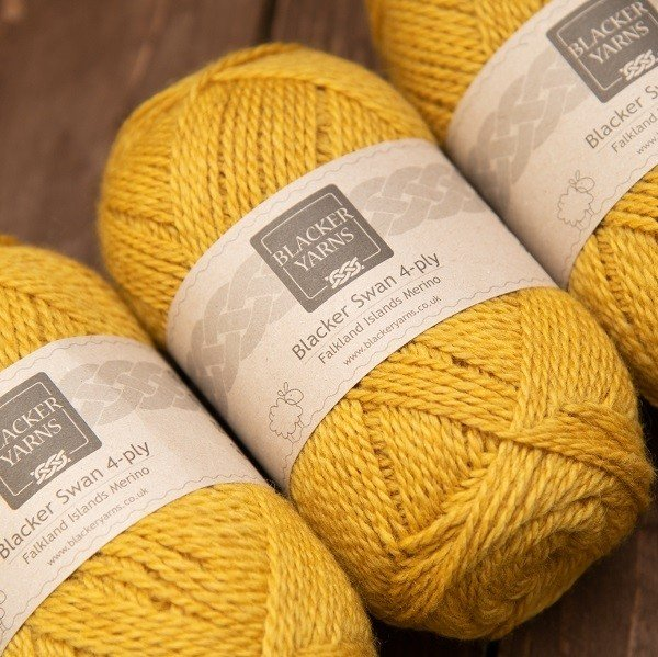 Blacker Swan over-dyed Sundew gold 4-ply knitting yarn
