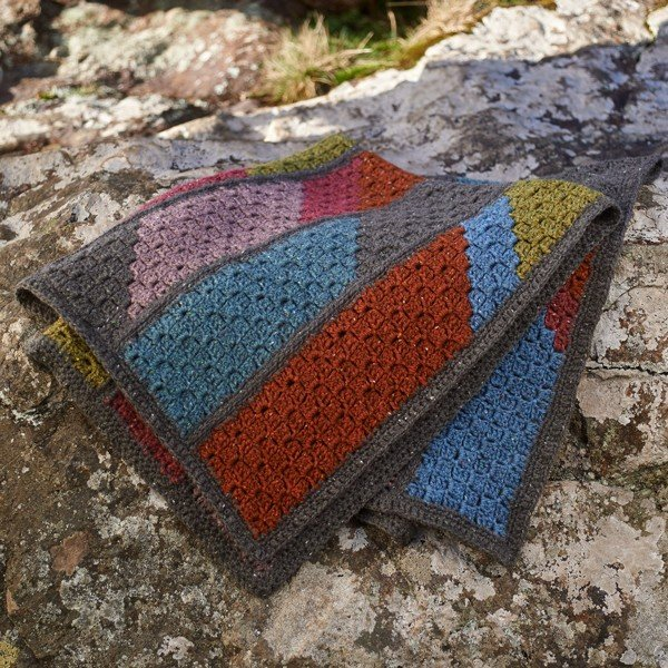 Lillerys Cove Blanket on Rock - Blacker Yarns